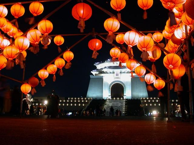 The sky is lit with lanterns and fireworks during Teng Chieh