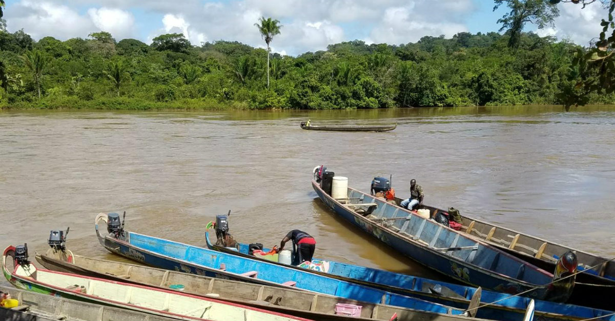 Long boats were the only way to visit most of the health clinics in Suriname.