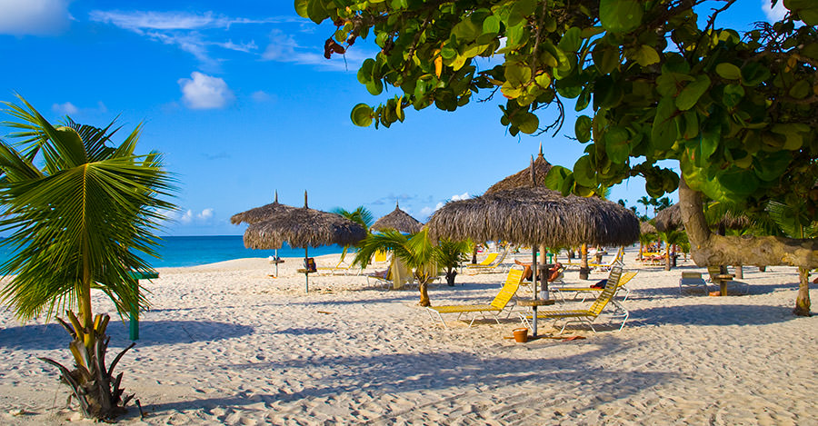 Aruba's beautiful beaches are amazing to visit. Make sure you're safe with Passport Health.