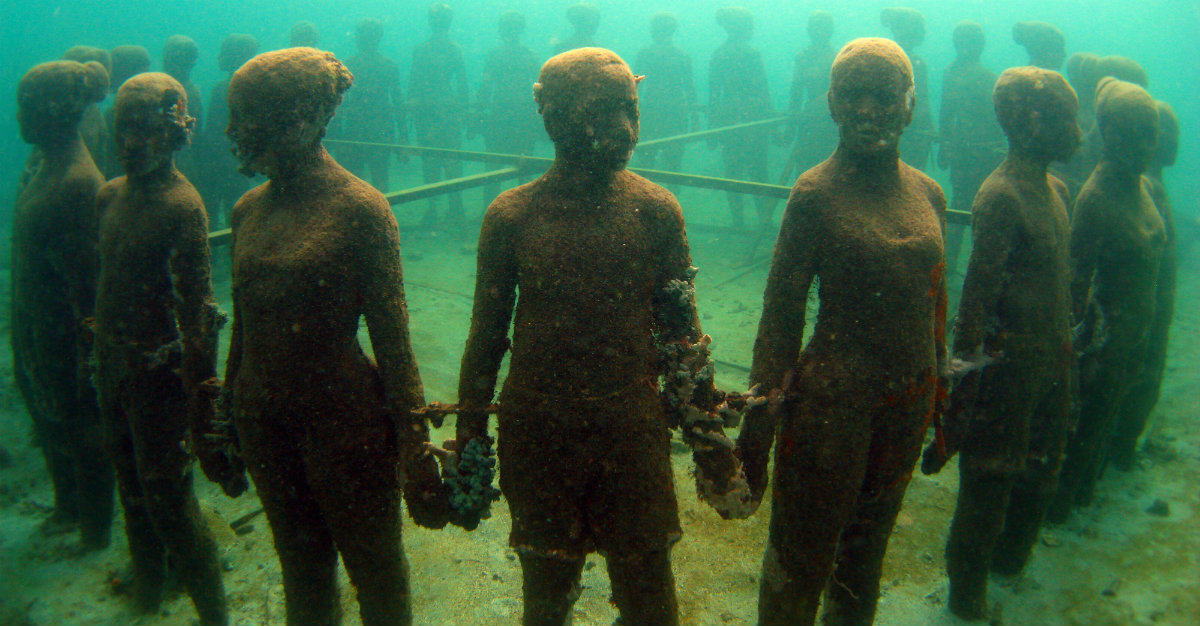 Statues in an underwater sculpture park.